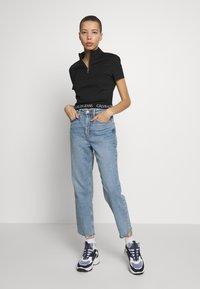Calvin Klein Jeans - LOGO ELASTIC MILANO HALF ZIP - Print T-shirt - black - 1
