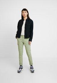 Calvin Klein Jeans - DRAPEY UTILITY SHIRT - Button-down blouse - ck black - 1