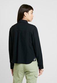 Calvin Klein Jeans - DRAPEY UTILITY SHIRT - Button-down blouse - ck black - 2