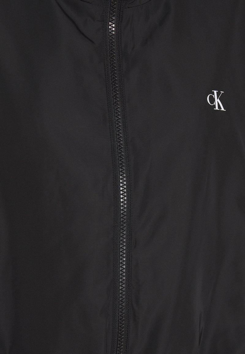 Calvin Klein Jeans BACK LOGO - Vindjakke - black