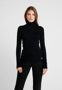 Calvin Klein Jeans - ICONIC TURTLE NECK - Stickad tröja - black - 0