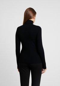 Calvin Klein Jeans - ICONIC TURTLE NECK - Stickad tröja - black - 2