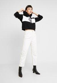 Calvin Klein Jeans - BLOCKING STATEMENT LOGO HOODIE - Hoodie - black/white - 1