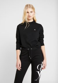 Calvin Klein Jeans - EMBROIDERY REGULAR CREW NECK - Sweatshirt - black - 0