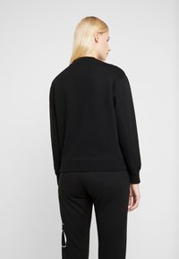 Calvin Klein Jeans - EMBROIDERY REGULAR CREW NECK - Sweatshirt - black - 2