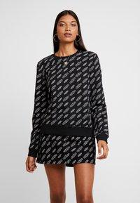 Calvin Klein Jeans - REGULAR CREW NECK - Sweatshirt - black beauty / bright white - 0