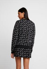 Calvin Klein Jeans - REGULAR CREW NECK - Sweatshirt - black beauty / bright white - 2