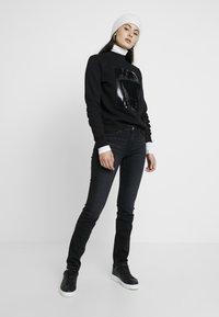 Calvin Klein Jeans - MOCK NECK - Sweatshirt - black - 1