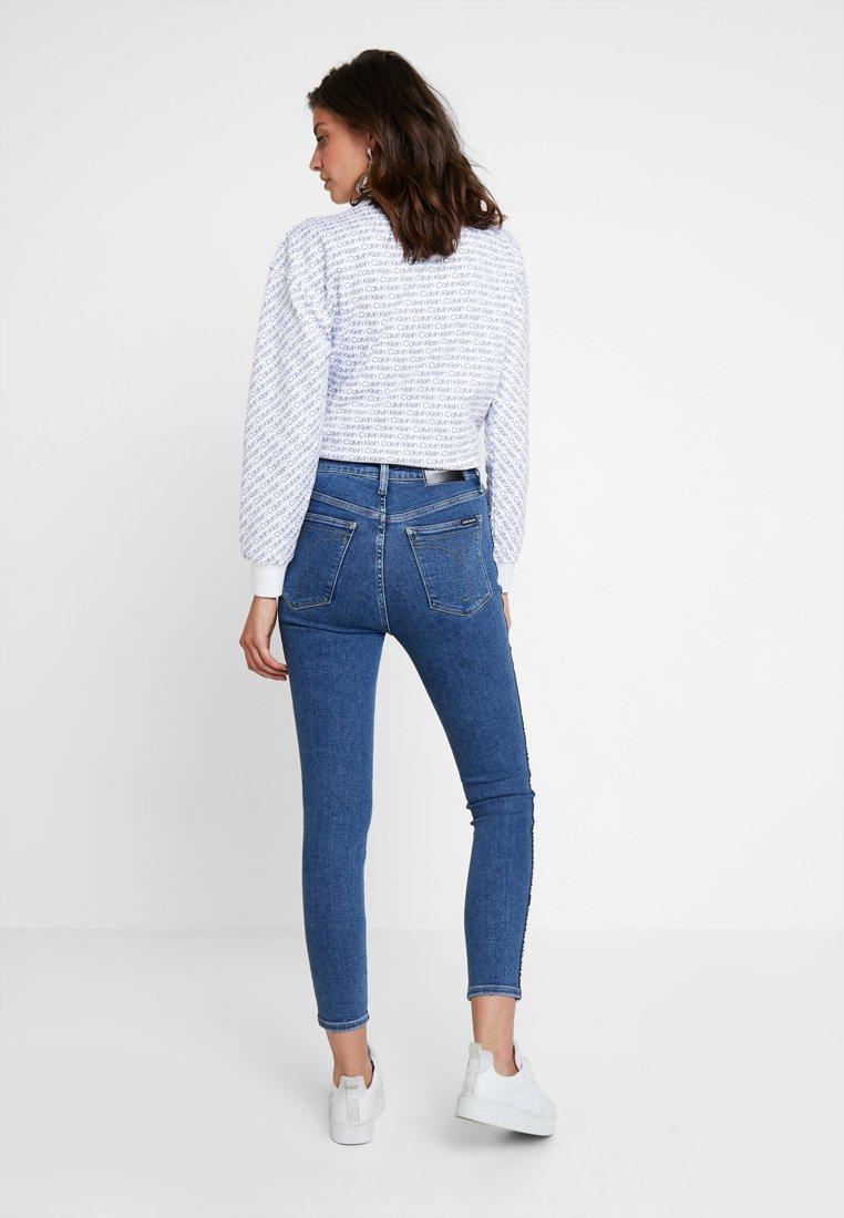 Calvin Klein Jeans 010 HIGH RISE SKINNY ANKLE - Jeansy Skinny Fit - dark blue denim
