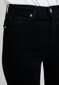 Calvin Klein Jeans - 010 HIGH RISE SKINNY ANKLE - Jeans Skinny Fit - black smart - 3
