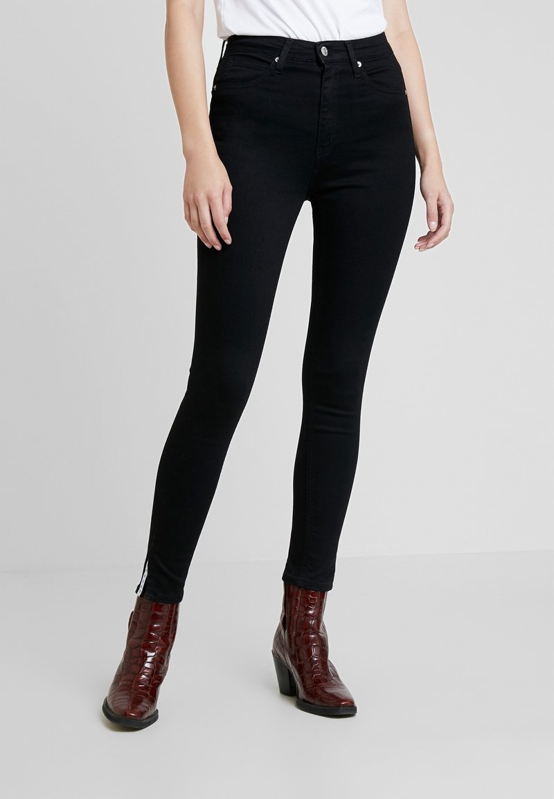 Calvin Klein Jeans - 010 HIGH RISE SKINNY ANKLE - Jeans Skinny Fit - black smart