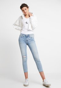 Calvin Klein Jeans - MID RISE CROP - Jeans Skinny Fit - everglades blueraw - 2