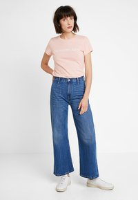 Calvin Klein Jeans - WIDE LEG ANKLE - Flared Jeans - iconic mid wear blue - 1