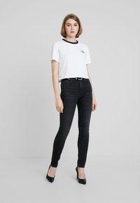 Calvin Klein Jeans - HIGH RISE SKINNY - Skinny džíny - iron horse black - 1