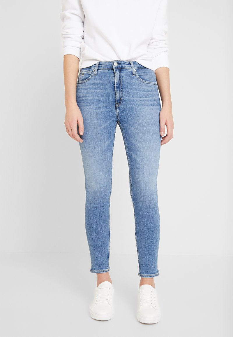 Calvin Klein Jeans - 010 HIGH RISE SKINNY ANKLE - Jeans Skinny Fit - mid blue