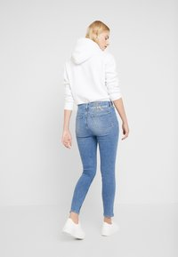 Calvin Klein Jeans - 010 HIGH RISE SKINNY ANKLE - Jeans Skinny Fit - mid blue - 2