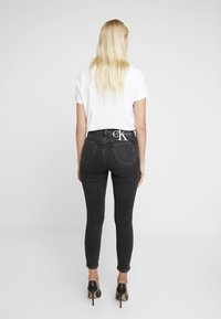 Calvin Klein Jeans - HIGH RISE - Jeans Skinny Fit - ca043 black - 2