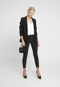 Calvin Klein Jeans - HIGH RISE - Jeans Skinny Fit - ca043 black - 1