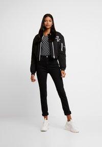 Calvin Klein Jeans - Jeans Skinny - washed black - 1