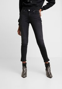 Calvin Klein Jeans - CKJ MID RISE SKINNY - Jeans Skinny Fit - black - 0