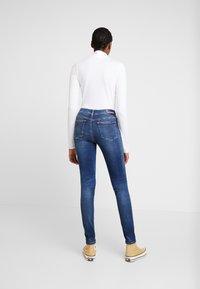 Calvin Klein Jeans - MID RISE SKINNY - Jeans Skinny Fit - blue dark - 2