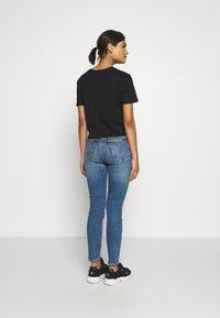 Calvin Klein Jeans - HIGH RISE SKINNY ANKLE - Skinny džíny - bright blue front - 2