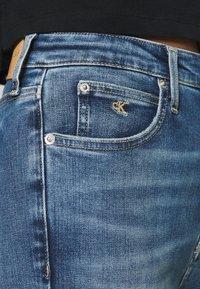 Calvin Klein Jeans - HIGH RISE SKINNY ANKLE - Skinny džíny - bright blue front - 5