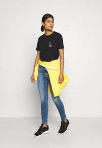 Calvin Klein Jeans - HIGH RISE SKINNY ANKLE - Skinny džíny - bright blue front - 1