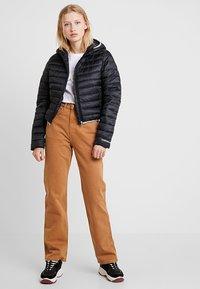 Calvin Klein Jeans - PADDED PUFFER WITH LOGO BINDING - Light jacket - black - 1