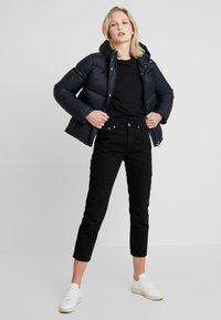 Calvin Klein Jeans - MONOGRAM TAPE PUFFER - Veste d'hiver - black - 1
