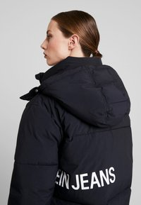 Calvin Klein Jeans - OVERSIZED LOGO PUFFER - Winter jacket - ck black - 5