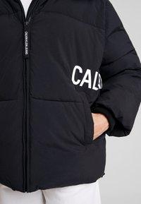 Calvin Klein Jeans - OVERSIZED LOGO PUFFER - Winter jacket - ck black - 7