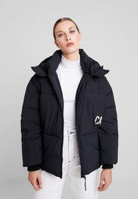 Calvin Klein Jeans - OVERSIZED LOGO PUFFER - Winter jacket - ck black - 0