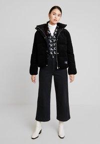 Calvin Klein Jeans - PUFFER JACKET - Zimní bunda - black - 1