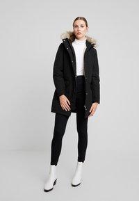 Calvin Klein Jeans - GERMANY SPECIAL PARKA - Doudoune - black - 1