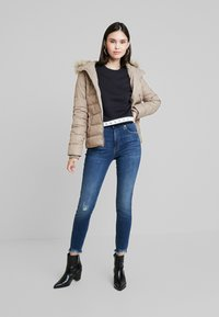 Calvin Klein Jeans - SHORT FITTED PUFFER - Light jacket - funghi - 1