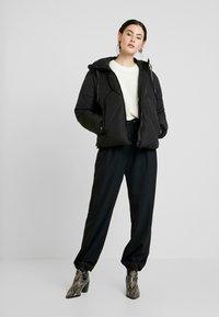 Calvin Klein Jeans - QUILTED PUFFER JACKET - Veste d'hiver - black - 1