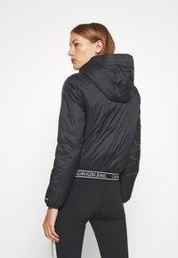 Calvin Klein Jeans - LOGO HOODED PADDED JACKET - Light jacket - black - 2