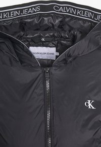 Calvin Klein Jeans - LOGO HOODED PADDED JACKET - Light jacket - black
