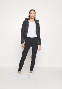 Calvin Klein Jeans - LOGO HOODED PADDED JACKET - Light jacket - black - 1
