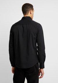 Calvin Klein Jeans - UTILITY MONOGRAM EMBRO REGULAR FIT - Koszula - black - 2