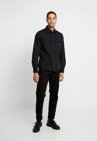 Calvin Klein Jeans - UTILITY MONOGRAM EMBRO REGULAR FIT - Koszula - black - 1