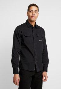 Calvin Klein Jeans - UTILITY MONOGRAM EMBRO REGULAR FIT - Koszula - black - 0