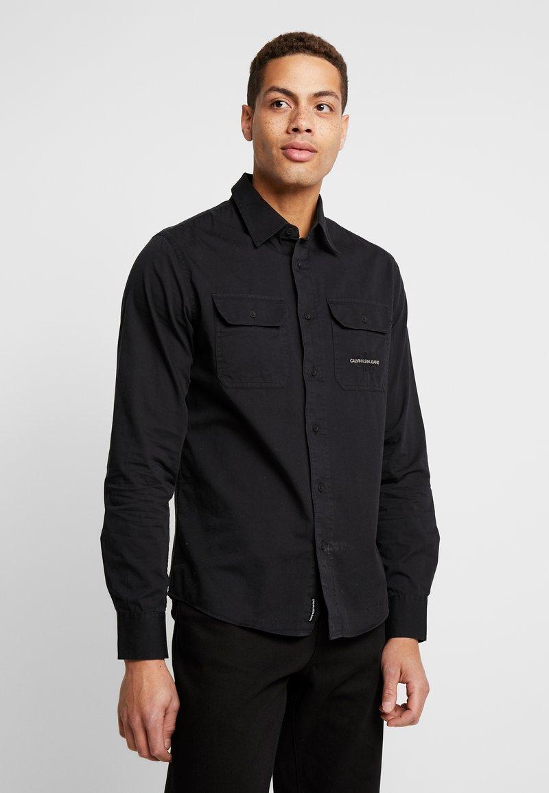 Calvin Klein Jeans - UTILITY MONOGRAM EMBRO REGULAR FIT - Koszula - black