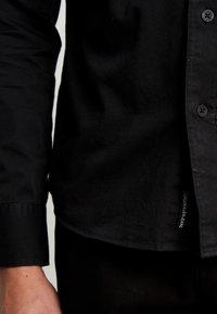 Calvin Klein Jeans - UTILITY MONOGRAM EMBRO REGULAR FIT - Koszula - black - 5