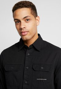 Calvin Klein Jeans - UTILITY MONOGRAM EMBRO REGULAR FIT - Koszula - black - 3