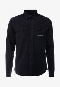 Calvin Klein Jeans - UTILITY MONOGRAM EMBRO REGULAR FIT - Koszula - black - 4