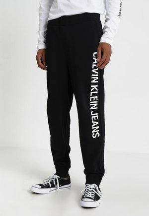 INSTITUTIONAL SIDE PANTS - Teplákové kalhoty - black