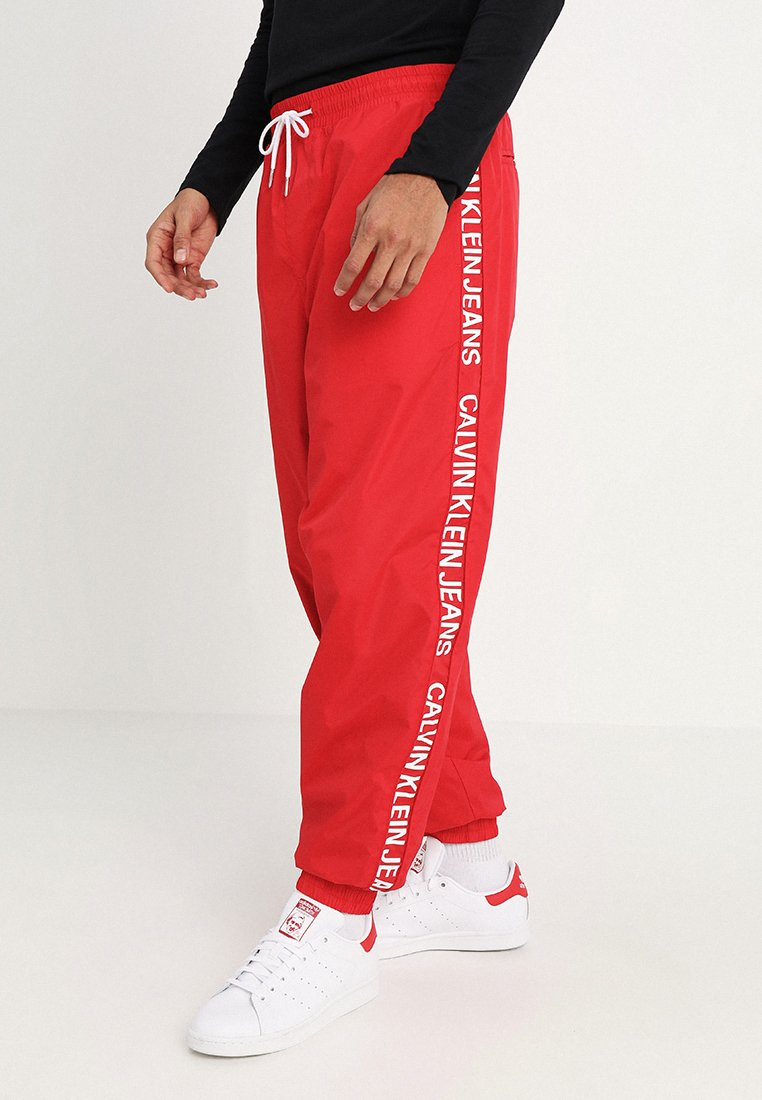 Calvin Klein Jeans - PANTS - Tracksuit bottoms - red