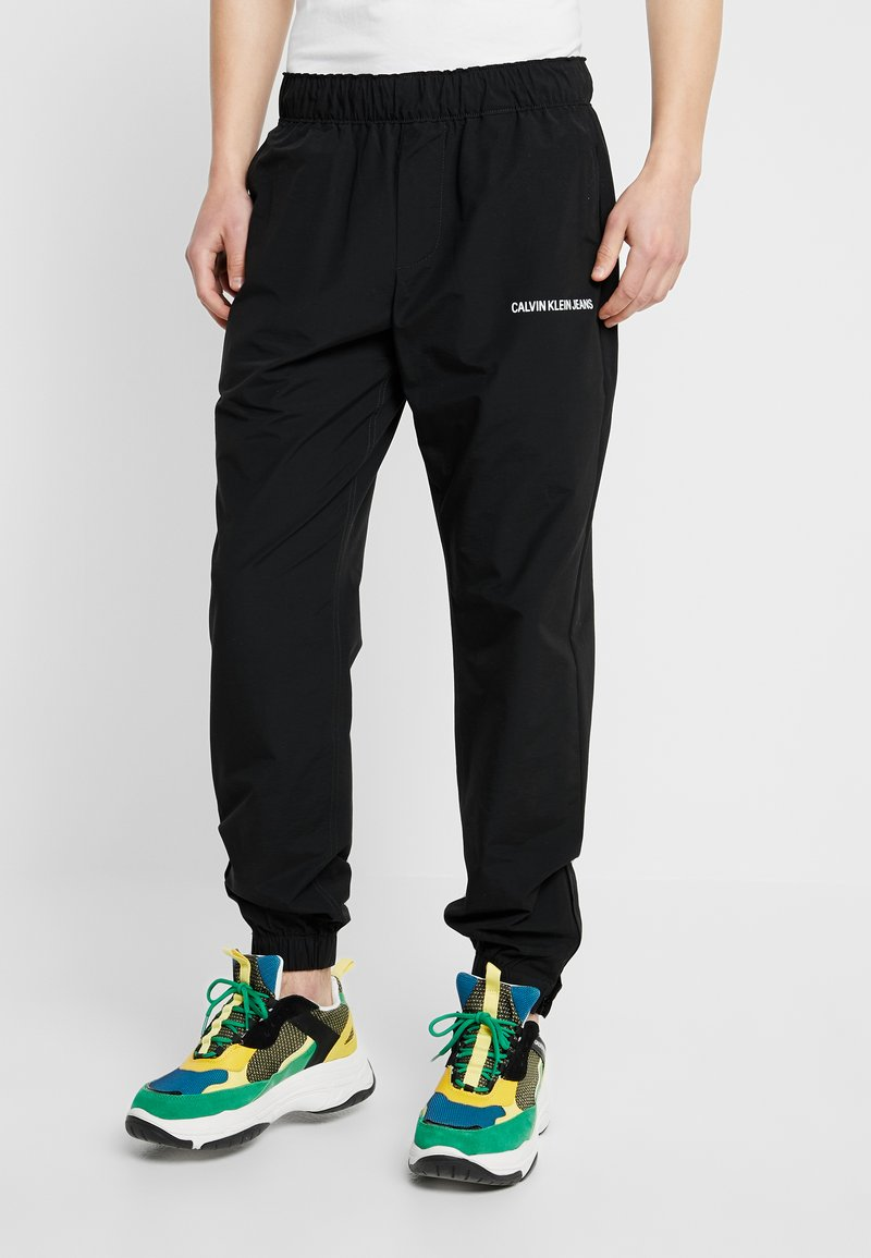 Calvin Klein Jeans - TRACK PANT - Teplákové kalhoty - black